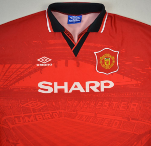 Manchester United Football Kit With Trafford Background